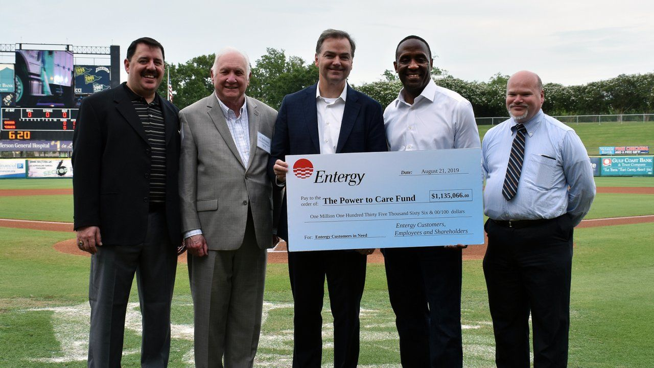 President and CEO of Entergy Louisiana Phillip May and president and CEO of Entergy New Orleans David Ellis (centered) were joined by nonprofit representatives for a check presentation at the New Orleans Baby Cakes baseball game on Wed., Aug. 21.