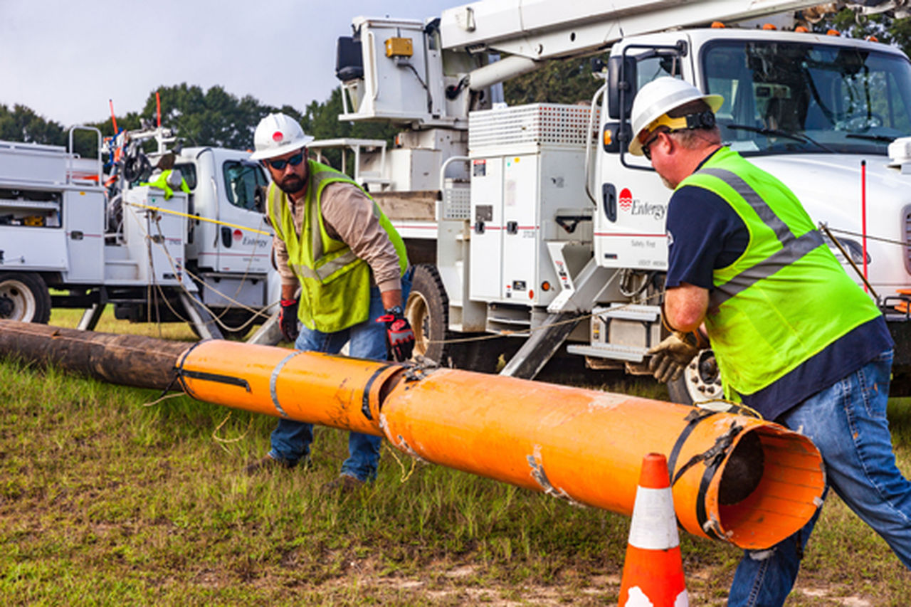 Entergy workers replace copper electrical wire with aluminum to improve safety and reliability.