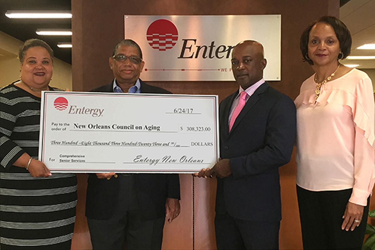 Entergy New Orleans President and CEO Charles Rice presents more than $300,000 to New Orleans Council on Aging Executive Director Howard Rodgers to help those in need. Joining them are Entergy New Orleans' Demetric Mercadel (l) and Toni Green-Brown (r).