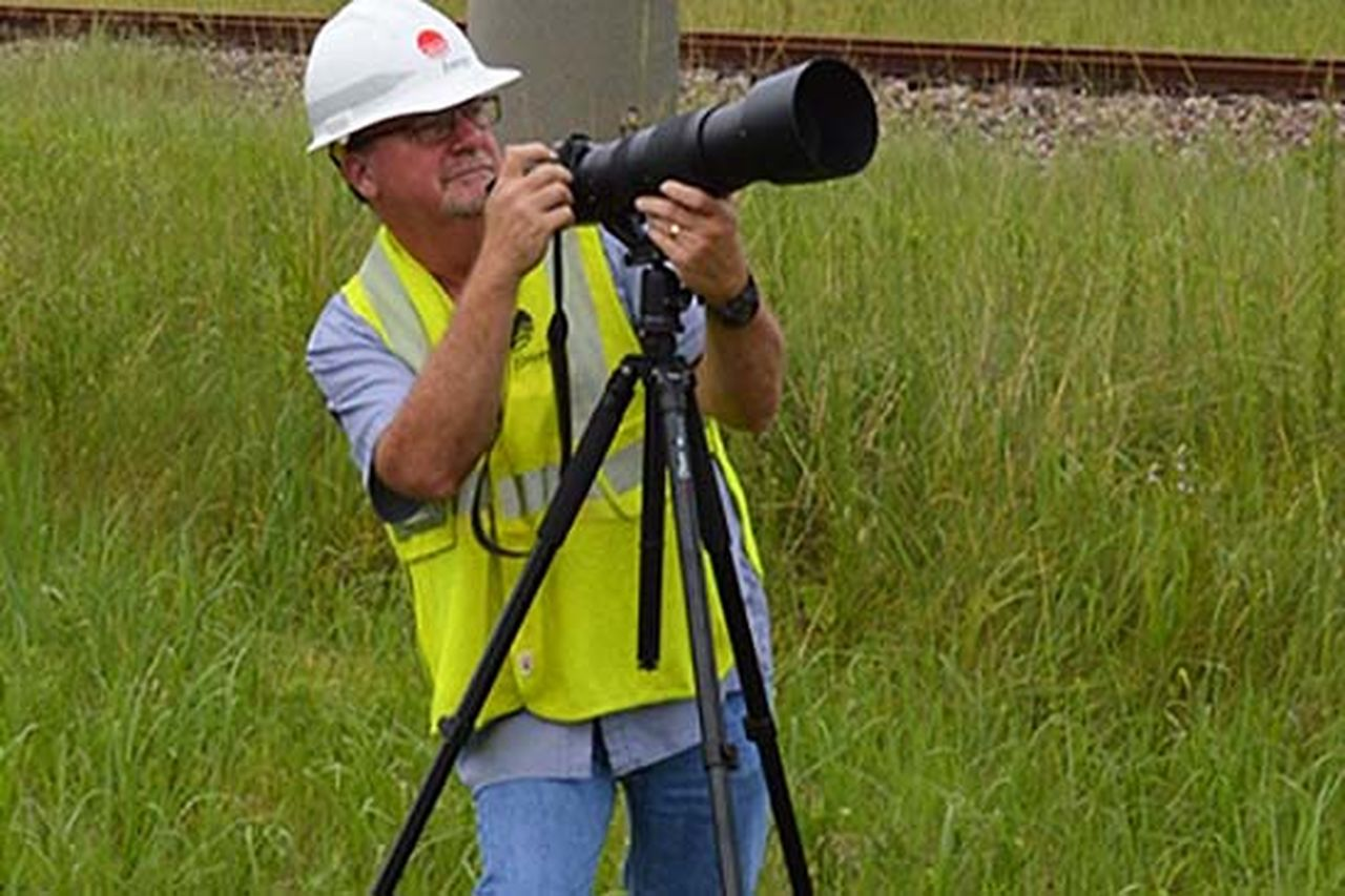 Entergy employee Pat Hoffpauir uses a high-powered camera to inspect the health of the electric grid.