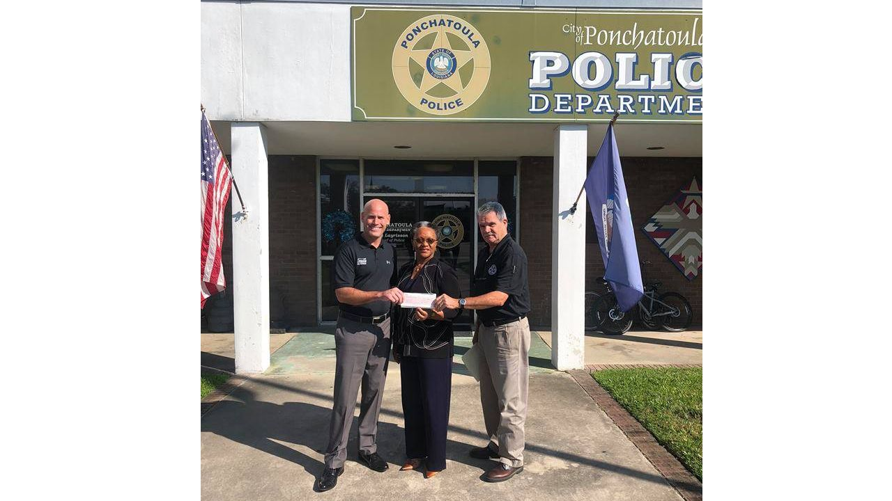 Entergy Louisiana Customer Service Representative Eunice Harris presents the grant check to Ponchatoula Police Chief Bry Layrisson (left) and Ponchatoula Police Assistant Chief Jim Betbeze (right).