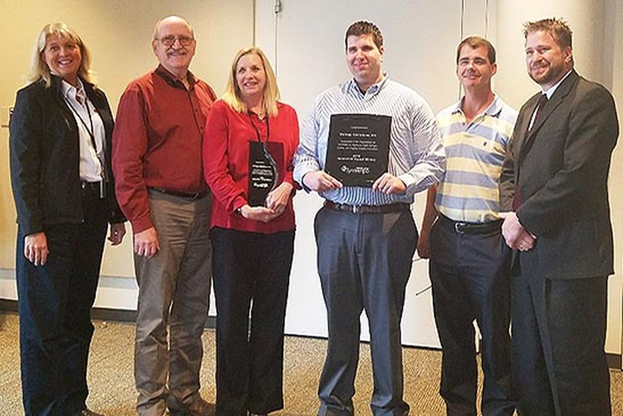 Charlie Sundling, CEO of Pipeline Software, presents the company's Innovation Award to Entergy employees Donna Jacobs, Vernon Leinneweber, Kelli Wulf-Stewart, Kenneth Green and Craig Trahan.