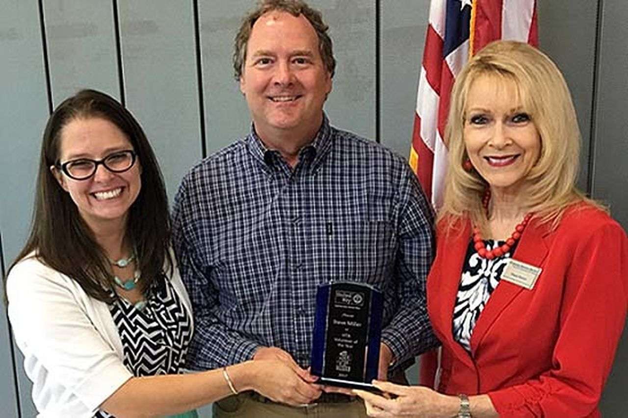 Entergy employee Steve Miller received the VITA Volunteer of the Year award from Capital Area United Way in April. Congratulating him are Heather Otten of CAUW (left) and Diane Denton of the Internal Revenue Service (right).