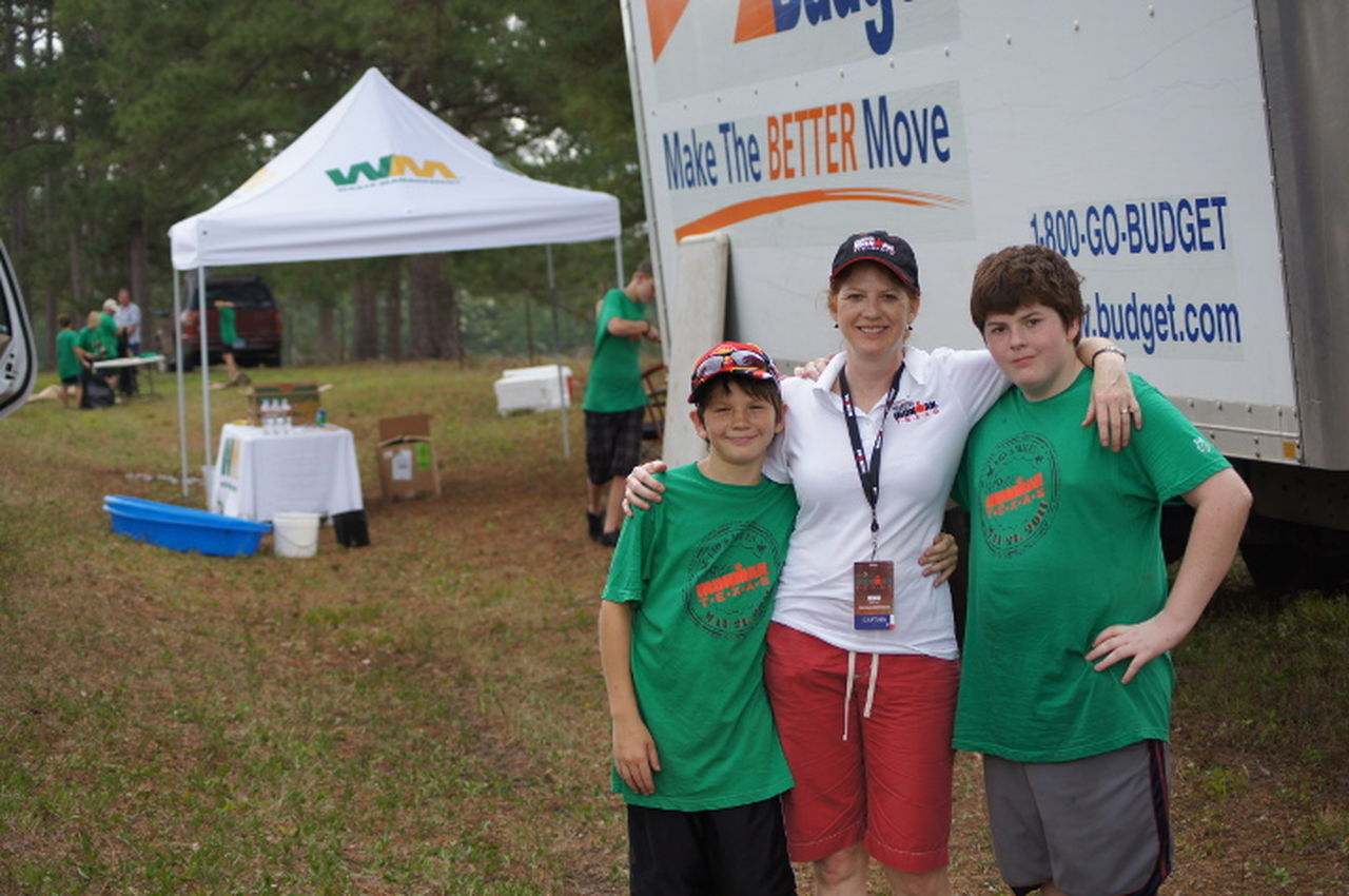 Entergy employee Dona Miller and her sons proudly volunteer for the Iron Man triathlon held annually in The Woodlands.