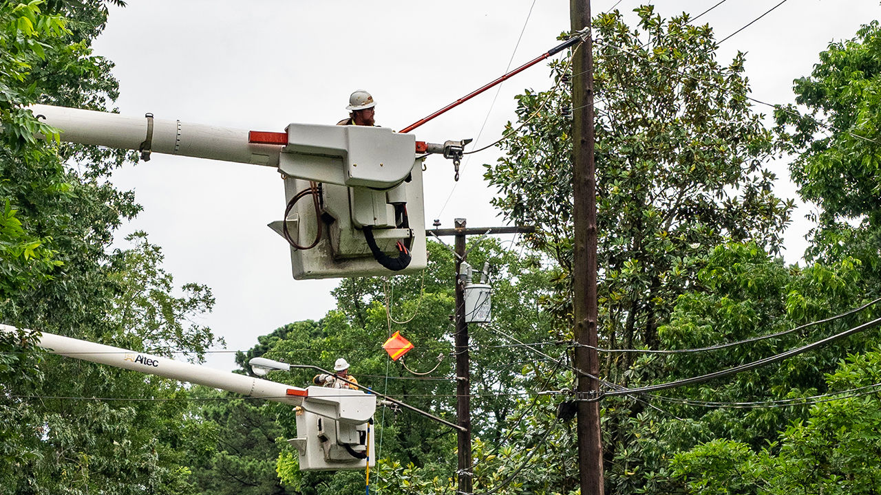 Crews in Jackson, Mississippi restore power outages caused by Tropical Storm Cristobal.