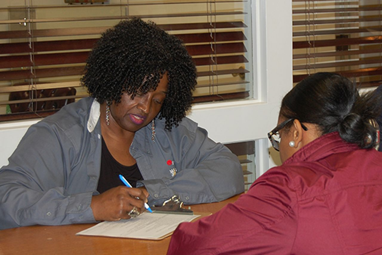 Sonya DuRonslet helps a customer prepare her taxes during Entergy Mississippi's Super Tax Day.