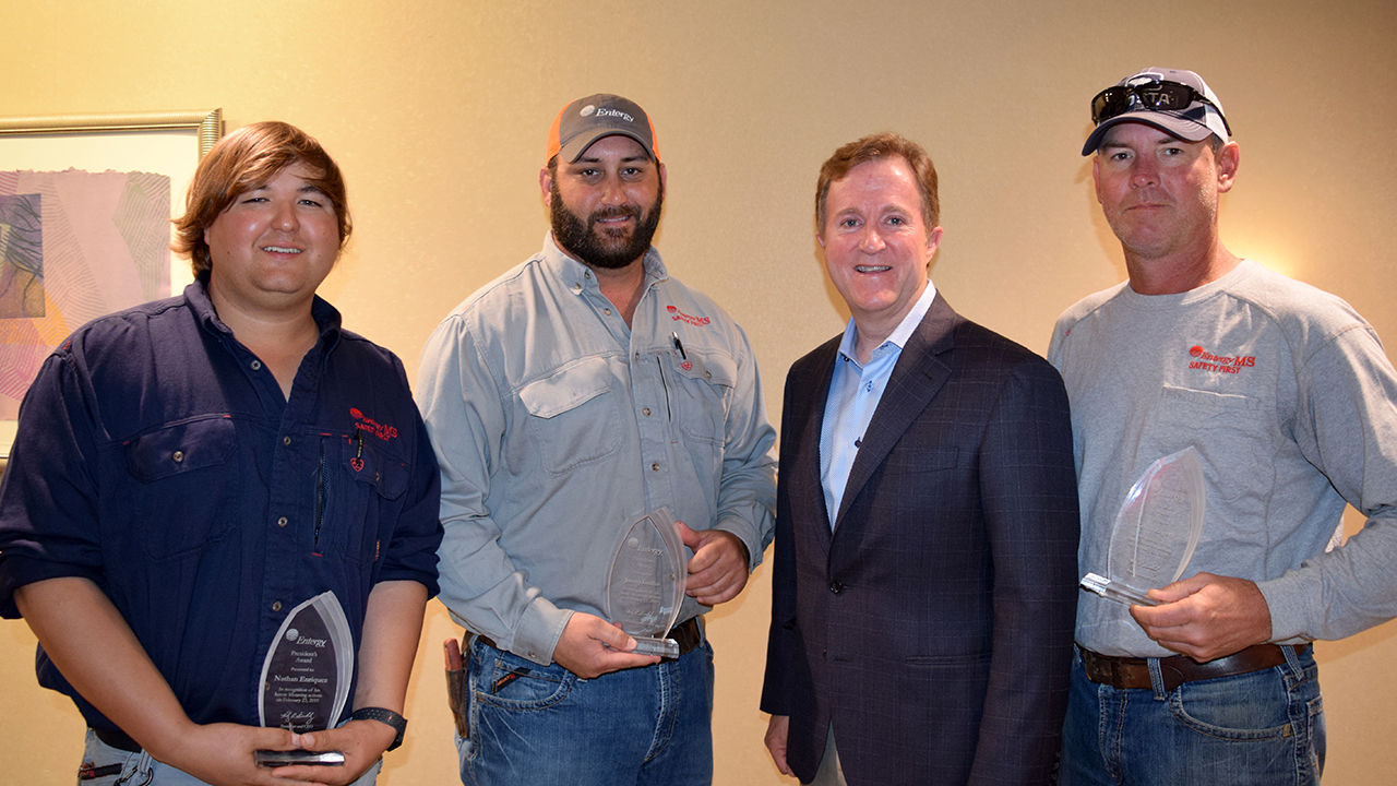 Nathan Enriquez, Justin Griffin and (far right) Kevin Rogers with President and CEO Haley Fisackerly