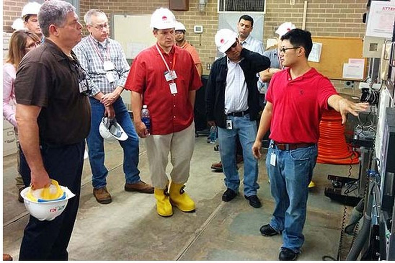 Dr. Chan Wong, senior engineer with Entergy, discusses the fiber project with leaders from other U.S. utilities during a site visit in September.