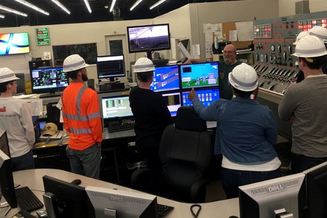 Nelson Plant Control Room Operator Ralph Midkiff shows students the control room and explains operators' daily job duties and responsibilities.