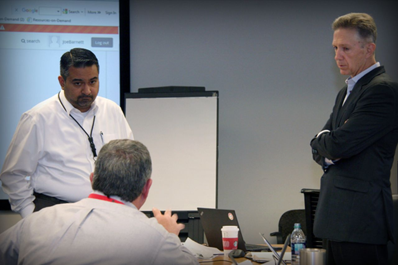 CIO Zeeshan Sheikh (left) and COO Paul D. Hinnenkamp participating in GridEX IV.