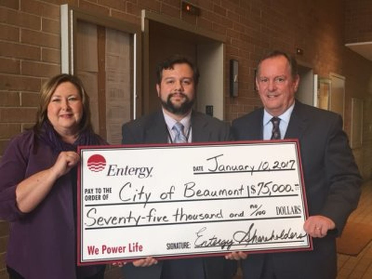 Pictured at the check presentation to the City of Beaumont are: Pamela Williams, Entergy Texas customer service representative; Carlos Aviles, City of Beaumont roadway designer and Vernon Pierce, Entergy Texas vice president of customer service.